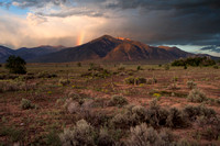 Rainbow at sunset on Taos Mountain